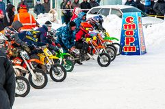 Winter Motocross competitions among children Royalty Free Stock Image