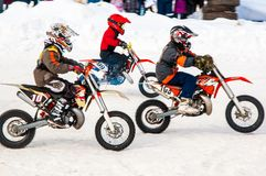Winter Motocross competitions among children Stock Photos