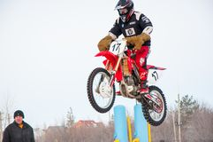 Winter Motocross competitions among Juniors. 10.03.2013, city of Orenburg, Southern Ural, Russia Stock Photos