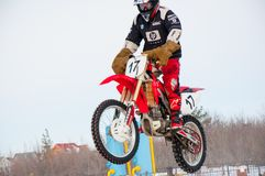 Winter Motocross competitions among Juniors. 10.03.2013, city of Orenburg, Southern Ural, Russiarnrnrn Royalty Free Stock Photos