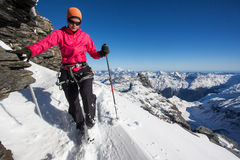 Winter mountain climbing. Young woman during winter mountain climb Stock Images