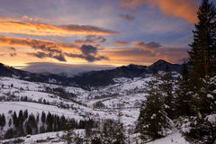 Winter mountain cloudy sunset Royalty Free Stock Image