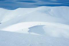 Winter mountain expedition. Expedition of people in the mountains Stock Images