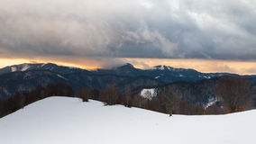 Winter mountain forest. Sunrise over the snowy forest mountains somewhere in Central Slovakia Stock Photos