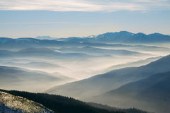 Winter mountain hills with fog Stock Images