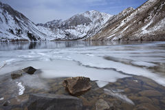 Winter at a mountain lake Stock Images