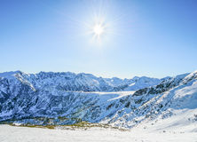 Winter mountain landscape against the blue sky. Stock Image