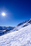 Winter mountain landscape against the blue sky. Stock Photos