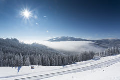Winter mountain landscape with blue sky Stock Photos