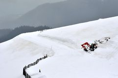 Winter mountain landscape with excavator on top Stock Image