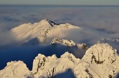 Winter mountain landscape with sea of clouds. Stock Photo