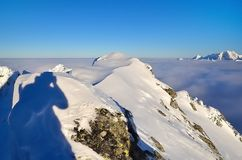 Winter mountain landscape with sea of clouds. Stock Photos