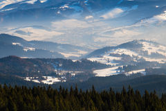 Winter mountain landscape . Ski resort Kubinska Hola; Slovakia. Winter mountain landscape - top view of snow, mist covered valley in the background of mountain royalty free stock photos