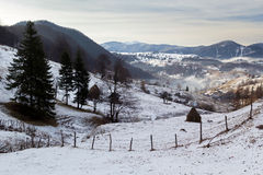 Winter Mountain Landscape. Winter snowy landscape above a village, in Carpathian Mountains at Bran - Moeciu, Romania Stock Image