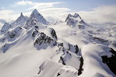 Winter mountain landscape in the Swiss Alps above Klosters with the Gross Litzner and Gross Seehorn mountain peaks. Winter mountain landscape in Alps of royalty free stock images