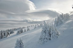 Winter mountain landscape, view from above. And cloud Altocumulus lenticuleris Royalty Free Stock Photography