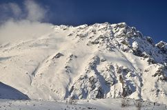 Winter mountain landscape. View over the snow-capped peak in Tatra mountains stock images