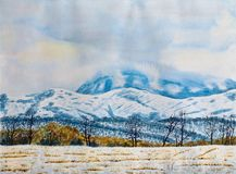 Winter mountain landscape. Watercolor painting on paper. Winter mountain landscape. A cloudy day, a snow-covered field with trees and mountains in the stock images