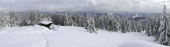 Winter mountain panorama with a cottage Royalty Free Stock Photography