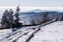Winter mountain panorama with snow covered road from Lysa hora hill in Moravskoslezske Beskydy mountains in Czech republic Stock Photography