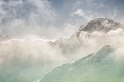 Winter mountain peaks in the clouds Stock Photo
