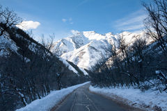 Winter Mountain Road and Mountain Royalty Free Stock Photography