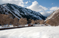 Winter Mountain Scene. Winter sense with lots of snow on a sunny day in the high mountains of Utah Stock Images