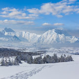 Winter mountain scene. By a bright day Royalty Free Stock Photo