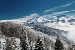 Winter mountain scenery and snow covered peaks in Europe Stock Photo
