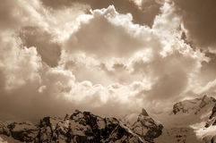 Winter mountain in sunlight clouds Stock Images