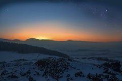 Winter mountain sunset with milky way Stock Photo