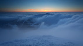 Winter mountain at sunset over clouds - time lapse video stock video
