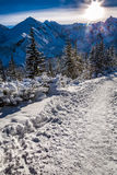 Winter mountain trail at sunrise Royalty Free Stock Images