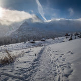 Winter mountain trail to a warm shelter, Tatras Stock Photo