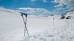 Winter mountain trail with two hiking poles Stock Photography