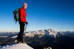 Winter mountain trekking. Young woman enjoying the view during winter mountain trip Stock Photo