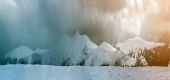Winter mountain view in Carpathian mountains with dramatic clouds stock photos