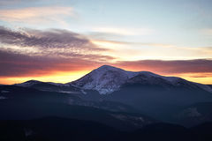 Winter mountain view of Petros. Winter landscape in the mountains at sunset with cloudy sky. Ukraine, Carpathian Mountains, the ridge Chernogora, Petros Stock Image