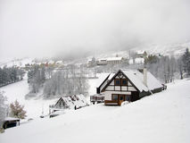 Winter in mountain village stock images