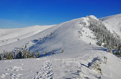 Winter mountain landscape. Snow at high altitude - Ciucas Mountains, landmark attraction in Romania Stock Photo