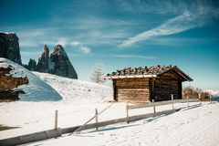 Winter mountainous landscape with rustic shelter Royalty Free Stock Photos