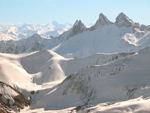 Winter in the mountains. Snow capped mountains. French Alps Royalty Free Stock Photos