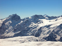 Winter in the mountains. Snow capped mountains. French Alps Royalty Free Stock Image