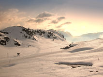 Winter in the mountains. Sunset in the snow-capped mountains. French Alps Stock Photography