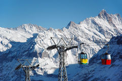 Winter mountains. Winter snowy Alps with cable railway cabins, Grindelwald in Bern Canton Switzerland Stock Photo