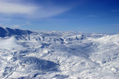 Winter in the mountains. Bright white Clouds and snow mounains (Turkey stock photo
