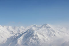 Winter mountains. Winter alpine mountains covered with snow Royalty Free Stock Photography