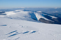 Winter Mountains. There are winter Mountains with dark forest and blue sky Stock Image