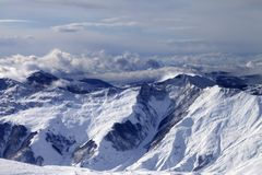 Winter mountains in clouds at windy day Royalty Free Stock Images