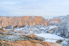 Winter in mountains. The colored rocks of Cappadocia are especially beautiful in winter, contrasting with snow, Turkey Royalty Free Stock Photography